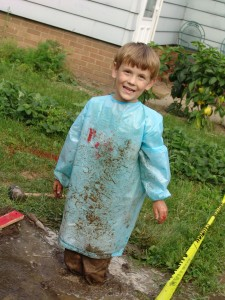 After a rousing afternoon with dirt and a hose, Gabe stood in about 4 inches of mud.  It was a very dirty day.